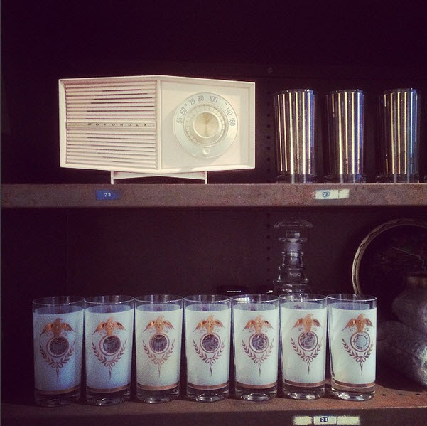 Cups on shelves with vintage radio